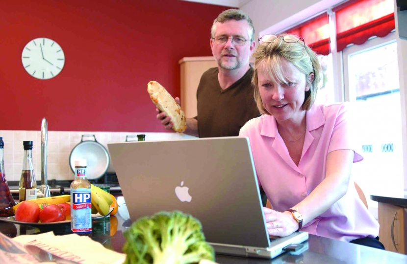 Couple with Computer in Kitchen